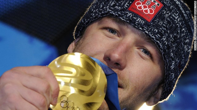 Bode Miller poses with Olympic gold in 2010.