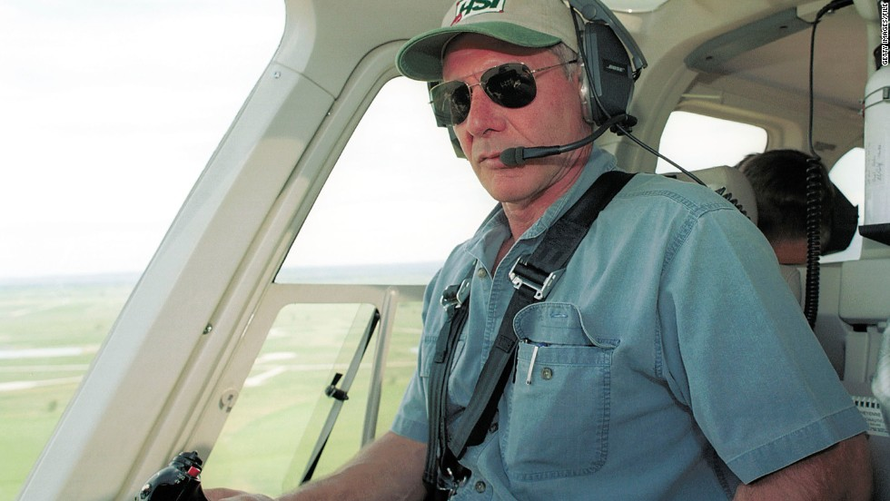 "In July 2001, Harrison Ford put his ""Indiana Jones""-honed instincts to good use <a href=""http://www.people.com/people/article/0,,622199,00.html"" target=""_blank"">by climbing into his helicopter</a> to help a search party looking for a missing 13-year-old Boy Scout outside Wyoming's Yellowstone National Park. When the boy was found almost seven hours later, cold and hungry but OK, Ford greeted him with a hug and a handshake."