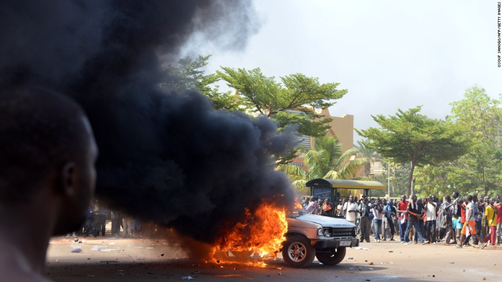 Cars and documents are set ablaze outside parliament on October 30.