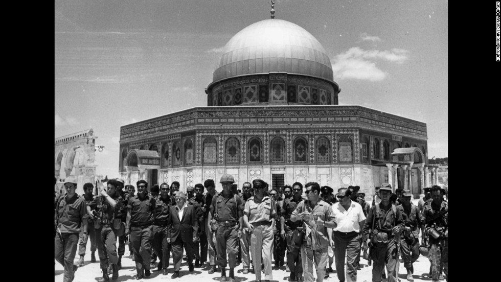 Israeli statesmen David Ben-Gurion and Yitzhak Rabin lead a group of soldiers past the Dome of the Rock in June 1967, during a victory tour following the Six-Day War. The dome in Jerusalem is part of the Temple Mount, the holiest site in Judaism and the third-holiest site in Islam. The Temple Mount, which Muslims know as Haram al-Sharif (the Noble Sanctuary), also includes the al-Aqsa Mosque and the Western Wall.