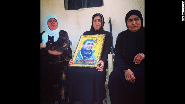 "KURDISH-CONTROLLED NORTHERN SYRIA:  Grieving Kurdish mother in northern Syria clutches portrait of her son Mehyedin. She says he was a fighter in the People's Protection Units (YPG), killed 2 months ago battling ISIS in the border town of Rabiyah. ""I'm proud of my son,"" she says. The women next to her also lost children in the Kurdish war against ISIS. - CNN's Ivan Watson, October 30.  Follow Ivan (@ivancnn) and other CNNers along on Instagram at instagram.com/cnn."