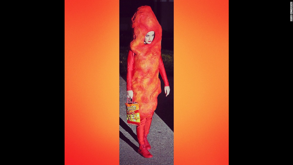 "<a href=""http://instagram.com/p/uz0xoYv-cu/?utm_source=partner&utm_medium=embed&utm_campaign=photo&modal=true"" target=""_blank"">Katy Perry</a> as a giant Cheeto."