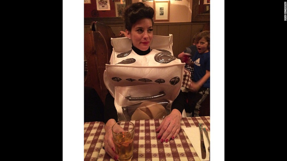 "Liv Tyler dressed as a stove. She wrote on her <a href=""http://instagram.com/p/uwa8QVQQQZ/?utm_source=partner&utm_medium=embed&utm_campaign=photo&modal=true"" target=""_blank"">Instagram </a>that she has a ""Bun in my oven..."""