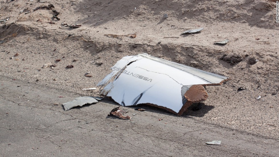 Debris from the rocket is scattered on a road after the rocket exploded.