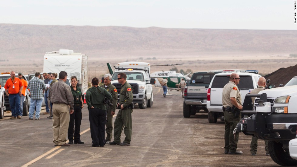 Law enforcement officers gather near the site where SpaceShipTwo exploded and crashed.
