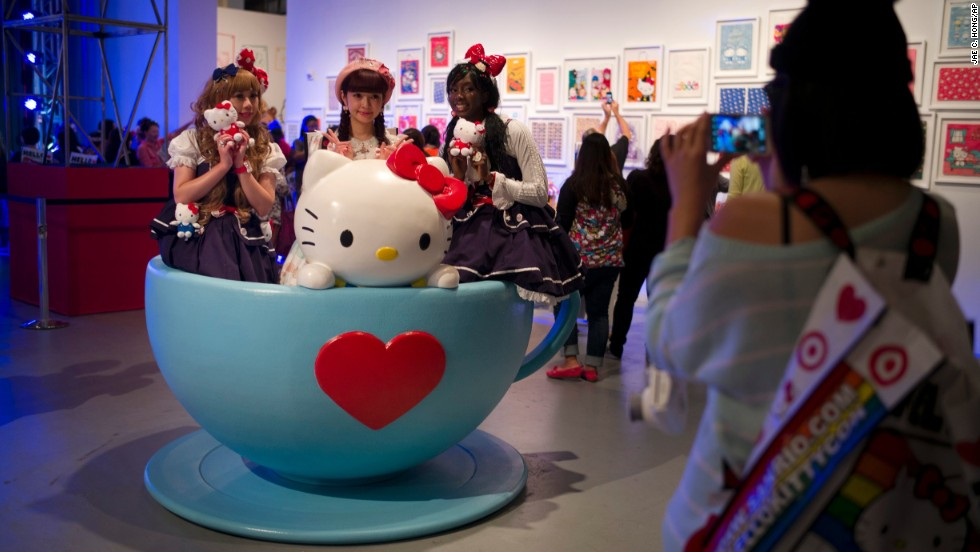 Hello Kitty fans pose for photos in a giant tea cup.