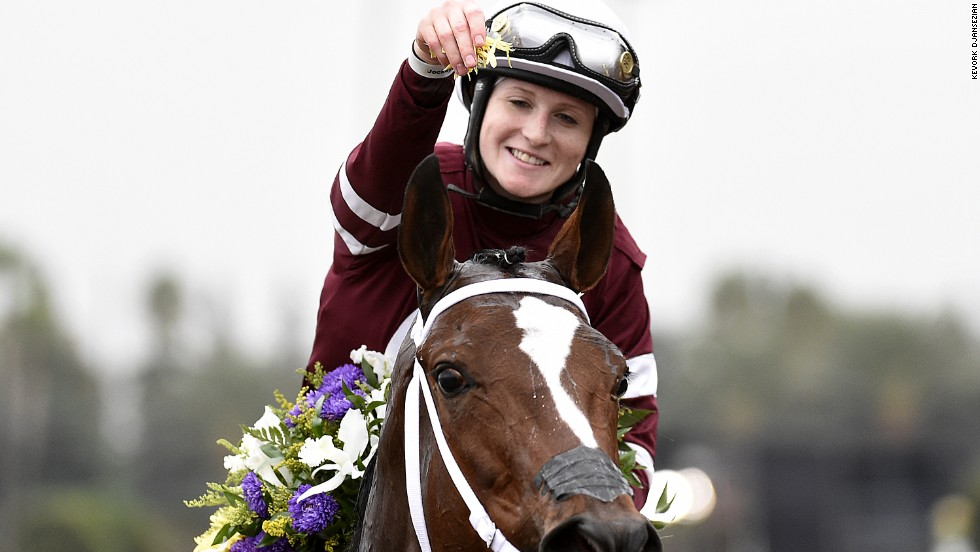 Rosie Napravnik celebrates atop Untapable after becoming the first female jockey to win the Breeders' Cup Distaff in Santa Anita, California. Napravnik would later announce she was retiring because she is seven weeks pregnant.