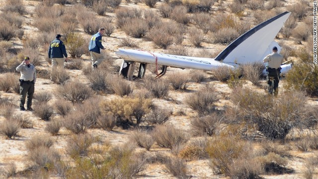An National Transportation Safety Board (NTSB) team surveys a tail section from the crashed Virgin Galactic SpaceShipTwo near Cantil, California, on November 01, 2014.