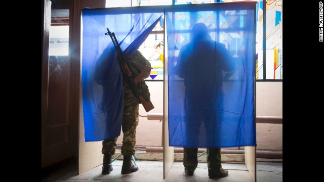Pro-Russian rebels fill their ballots at a polling station during rebel elections in the city of Donetsk, Ukraine, on Sunday, November 2.