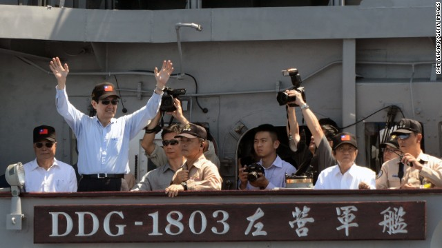 Taiwan's President Ma Ying-Jeou, left, waves from a warship during naval drills at sea on September 17.