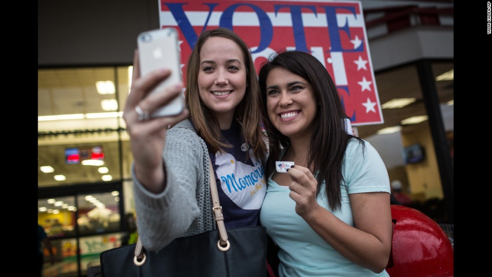Lauren Koepp and Kara Smyth take a selfie after casting votes in Austin, Texas.