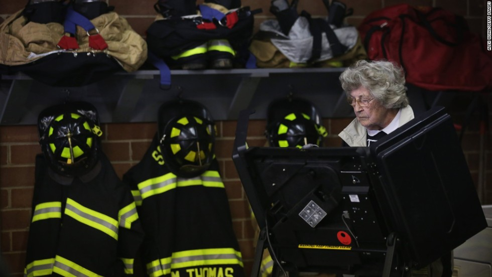 A voter casts her ballot at a fire station in Climax, North Carolina.