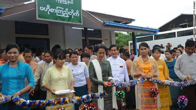 Aung San Suu Kyi (c) pictured opening a new mobile library in Kawhmu township on the outskirts of Yangon in 2013.