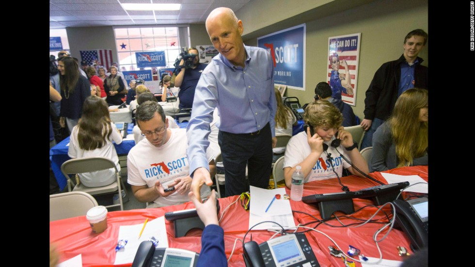 Scott stops by a Republican call center to rally campaign workers on November 4 in Fort Myers, Florida.