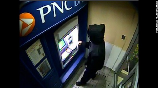 Abducted Philly Woman - ATM surveillance photos Caption: 	(CNN) -- Two days after a Philadelphia woman's abduction was captured on video, police say they have a lead across the state line: Someone used her bank card Tuesday morning in Maryland. A male used Carlesha Freeland-Gaither's ATM card at 6:01 a.m. a bank in Aberdeen, Maryland, about a 75-mile drive southwest from the Philadelphia street where she was forced into a car on Sunday night, Philadelphia police Chief Inspector Dennis Wilson told reporters.