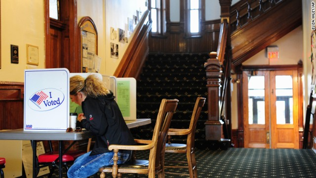 Jefferson County, Montana resident Samantha Mongoven sits in the hallway of the historic courthouse in Boulder, Mont., Tuesday, Nov. 4, 2014, to cast her mid-term election votes. (AP Photo/)