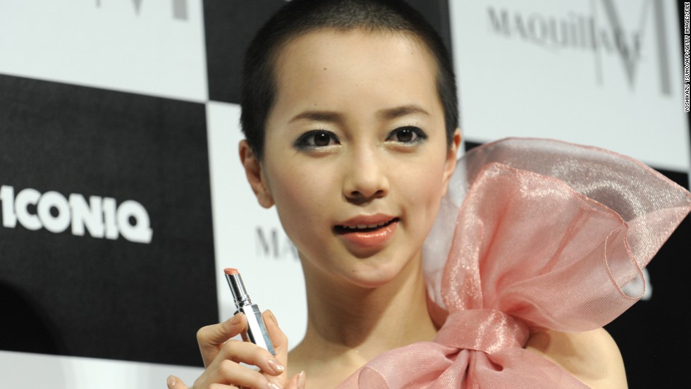 "Here, pop singer Iconiq displays a Shiseido lipstick on January 19, 2010, after becoming the model for the Japanese cosmetics giant's ""Maquillage"" make-up brand."