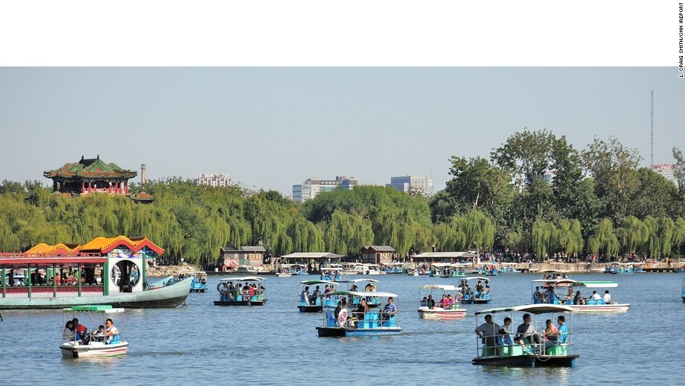 "Colorful boats float along a lake at the<a href=""http://ireport.cnn.com/docs/DOC-850856""> Summer Palace </a>in Beijing, China. The historic site, which was <a href=""http://whc.unesco.org/en/list/880"" target=""_blank"">restored in 1886</a> after being ravaged by war, is dotted with beautiful gardens, pavilions and temples."