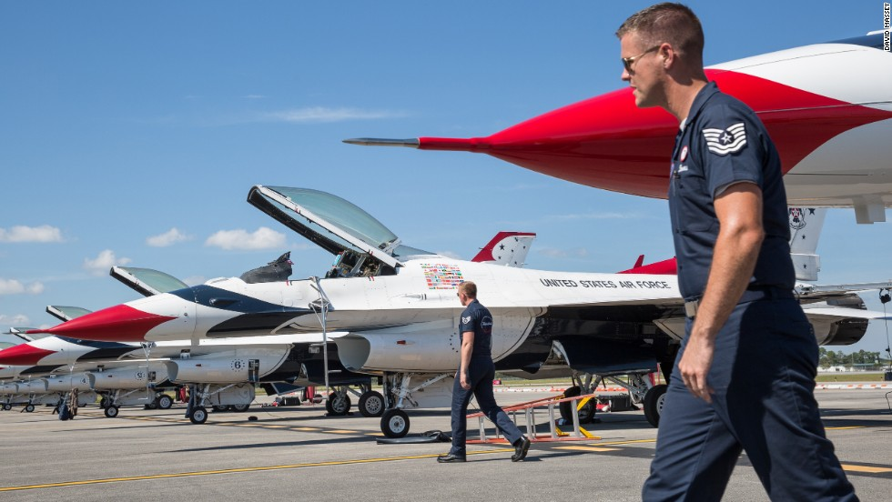 The Thunderbirds team keeps eight F-16 airplanes ready on the flight line at Daytona Beach International Airport before the Embry-Riddle Aeronautical University's Wings and Waves Air Show.