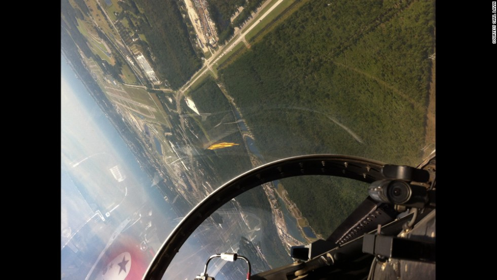 Sharp turns and unusual views of the horizon add to the thrills of a ride in a fighter jet. After an hour demonstration ride with the Thunderbirds, this was the scene through the canopy heading for a landing on runway 7-L at Daytona Beach, which is visible in the top left part of the frame.