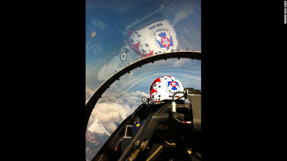 The bubble canopy on the Thunderbird F-16 covers the pilot, Maj. Michael Fisher, and the second seat area, where a passenger can almost reach ahead and tap the pilot on the shoulder.