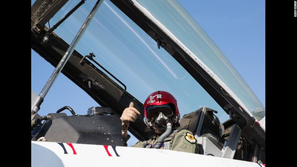 CNN's Carl Lavin gives a thumbs up before his flight at the Embry-Riddle Aeronautical University's Wings and Waves Air Show in Daytona Beach.