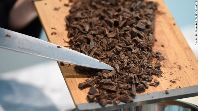 A chocolate-maker makes a preparation during a preview of the Belgium Chocolate Village, a museum dedicated to Belgium's chocolate-making history, in Brussels, on September 19, 2014. The museum, located in one of Brussels' oldest chocolate factory, the former Victoria biscuit and chocolate factory, is scheduled to open on September 20, 2014. The museum will be one of the largest museum dedicated to chocolate's history. AFP PHOTO/Emmanuel Dunand (Photo credit should read EMMANUEL DUNAND/AFP/Getty Images)