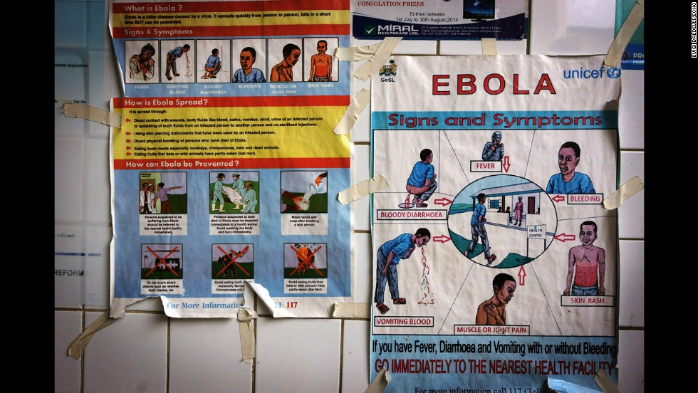 Posters warn and explain the symptoms ebola. (Luigi Baldelli/ECHO)