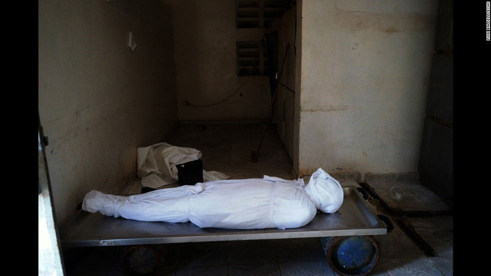 The body of a man who died of Ebola lays in the mortuary. (Luigi Baldelli/ECHO)