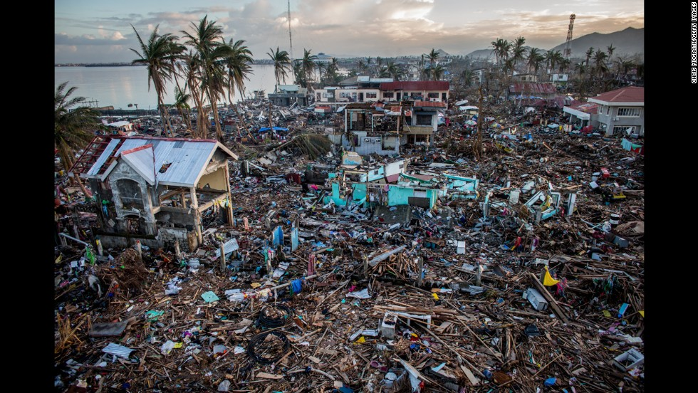 Typhoon Haiyan, which ripped through the Philippines on November 9, 2013, has been described as one of the most powerful typhoons to hit land, leaving thousands dead and hundreds of thousands homeless. A year later, people continue to repair their lives. Here, a general view of the destroyed coastline in Tacloban City on November 17, 2013, in Leyte.