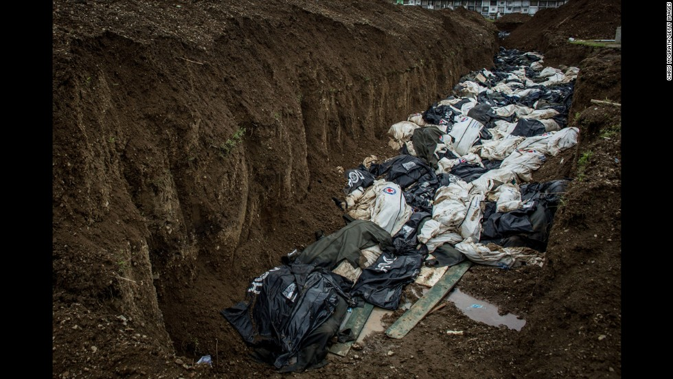 Bodies are seen in a mass grave on the outskirts of Tacloban City on November 20, 2013.