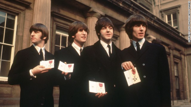 British pop group The Beatles, from left to right; Ringo Starr, John Lennon (1940 - 1980), Paul McCartney and George Harrison (1943 - 2001), outside Buckingham Palace, London, after receiving their MBE's (Member of the Order of the British Empire) from the Queen