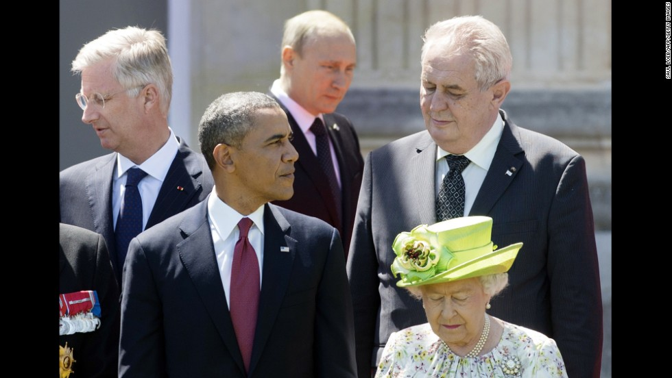 Putin walks behind Obama and Queen Elizabeth during a group photo of world leaders attending the D-Day 70th anniversary ceremonies in June 2014 in Benouville, France.