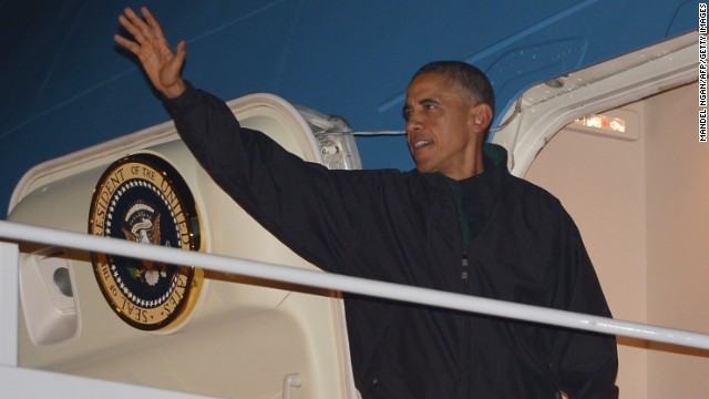 President Barack Obama waves as he boards Air Force One, Sunday, Nov. 9, 2014, at Andrews Air Force Base, Md. Obama is traveling to the Asia-Pacific region for a week of international summits. MANDEL NGAN/AFP/Getty Images)