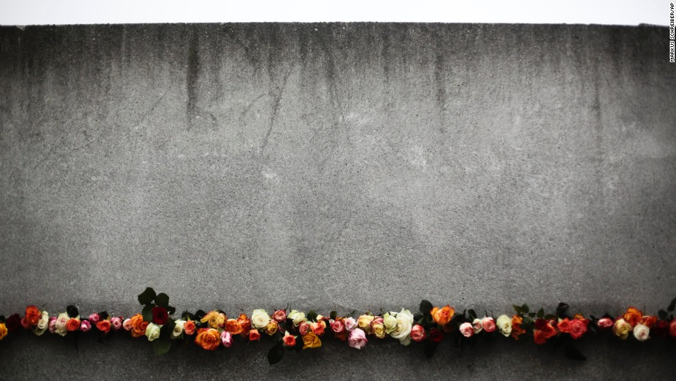 Flowers are placed in a crack of the former Berlin Wall to commemorate the victims killed at the wall.