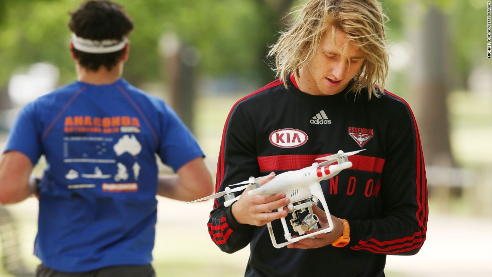 Drones are a part of training sessions now, too. Aussie Rules player Dyson Heppell babysits one while training with the AFL's Essendon Bombers in November 2014.