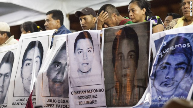 MEXICO CITY, MEXICO - NOVEMBER 5: Families of 43 missing students from Guerrero State in Mexico protest the government and demand answers of the missing students on November 5, 2014 in Mexico City, Mexico. The students have been missing since September 26, 2014 and are from the Atyotzinapa teaching college in Iguala, Mexico. (Photo by Brett Gundlock/Getty Images)