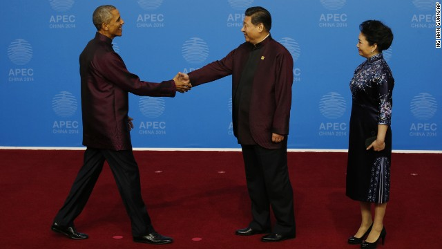 U.S. President Barack Obama, left, is greeted by Chinese President Xi Jinping and his wife, Peng Liyuan, for the dinner hosted by Xi for APEC leaders at the Beijing National Aquatics Center in Beijing, Monday, Nov. 10, 2014. (AP Photo/Ng Han Guan)