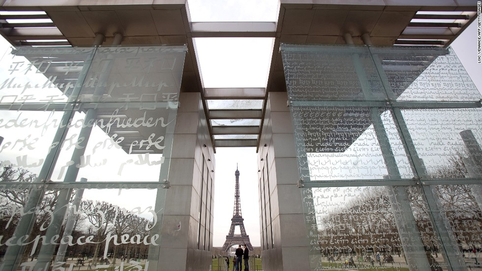 """<em><strong>Peace Wall by Clara Halter and Jean-Michel Wilmotte, Paris, 2000</strong></em><br /><br />Whereas monuments once tended to celebrate tremendous victories, since WWI the emphasis has been to commemorate loss or to call for peace. (<em>The Peace Wall</em> in Paris, created by artist Clara Halter and architect Jean-Michel Wilmotte, attempts the latter by repeating the word """"peace"""" in 32 languages). <br /> <br />After the incredible loss of WWI, imposing structures -- classically inspired arches and obelisks -- provided a place to focus one's grief, especially when bodies weren't sent home.<br />    <br />""""They had to be in stone, marble or bronze because people wanted something of permanence,"""" explains Paul Gough, a professor of art history at <a href=""""http://www.rmit.com/"""" target=""""_blank"""">RMIT University</a> in Melbourne, Australia. """"They wanted something that was heroic and larger than life that could somehow symbolize that the dead had died for something other than just a common cause."""""""
