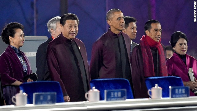 Chinese President Xi Jinping (2 L) and US President Barack Obama (C) prepare to watch the fireworks show during the Asia-Pacific Economic Cooperation (APEC) summit in Beijing on November 10, 2104. Leaders of more than half the world's economy gather in Beijing over the next week for the annual APEC forum, with China and the US pushing rival trade agreements as the week-long series of international summits gets under way. AFP PHOTO / WANG ZHAOWANG ZHAO/AFP/Getty Images