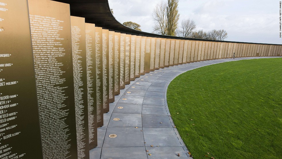 """<em><strong>International Memorial at Notre Dame de Lorette by Phiippe Prost, Ablain-Saint-Nazaire, 2014 </strong></em><br /><br />Since then, loss has become a more personal experience due to what Gough calls """"the democratization of memory."""" Technology and official censuses have made it easier to track down one's relatives, including the dead, which makes the desire to commemorate more personal. <br /><br />Architect Phiippe Prost's international memorial at Notre Dame de Lorette in Ablain-Saint-Nazaire, which was inaugurated today, attempts to do just that. The elliptical ring's bronze plates are engraved with the names of the 579,606 servicepersons from both sides who died in Northern France during WWI."""