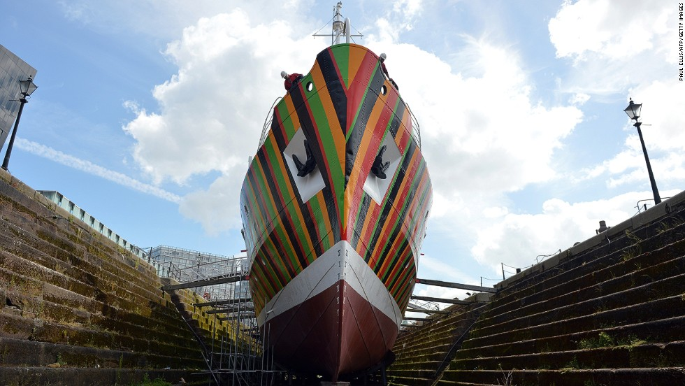 """<strong><em>Dazzle Ship by Carlos Cruz-Diez, Liverpool, 2014 </strong></em><br /><br />Waldman encourages artists to explore the stories that the public isn't as familiar with. <em>Dazzle Ships</em>, a commission by Venezuelan artist Carlos Cruz-Diez and German sculptor Tobias Rehberger, for example, pays homage to the artists whose bright, geometric """"dazzle"""" camouflage on WWI ships confounded opponents."""