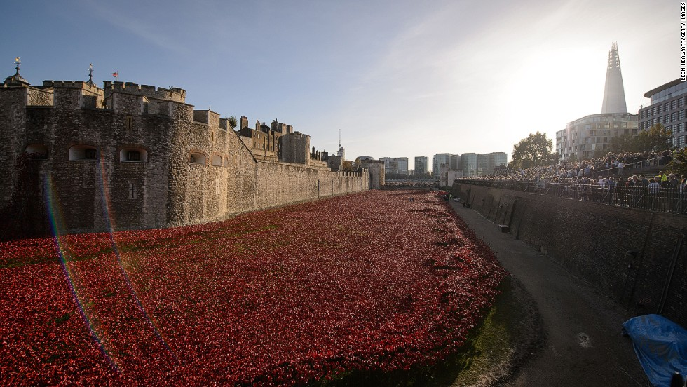 """<em><strong>Blood Swept Lands and Seas of Red by Paul Cummins and Tom Piper, London, 2014 </strong></em><br /><br />Since the first poppies were unveiled in the Tower of London moat on August 5, no less than four million people have visited the WWI memorial installation. Designed by ceramics artist Paul Cummins and set designer Tom Piper, <a href=""""http://edition.cnn.com/2014/11/07/world/europe/tower-of-london-poppies/index.html?hpt=hp_c1""""><em>Blood Swept Lands and Seas of Red</em>'s</a> 888,246 flowers -- one for every British serviceperson who lost their life during WWI -- has become an international sensation.<br /><br />With its sheer size, delicate beauty and poignant message, the installation is a departure from some of the more statuesque monuments the British public is familiar with. Indeed, artists from across disciplines are today using a contemporary vocabulary to express collective grief while conveying hope for the possibility of peace. Here we explore just a small snapshot of some of them. By <strong><a href=""""https://www.twitter.com/allyssiaalleyne"""" target=""""_blank"""">Allyssia Alleyne</strong></a>, for CNN"""