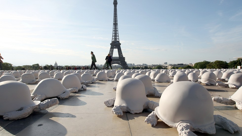 <strong><em>Peace Turtles by Rachid Khimoune, Paris, 2011 </strong></em><br /><br />Artist Rachid Khimoune set up 1000 turtles made from casts of German, Russian and American helmets in front of important French sites, most recently at Trocadero gardens near the Eiffel Tower in 2011. By having the turtle, which Khimoune considers a symbol of wisdom and humanity, wear a war helmet as its shell, Khimoune aims to express the senseless inhumanity of global conflict.