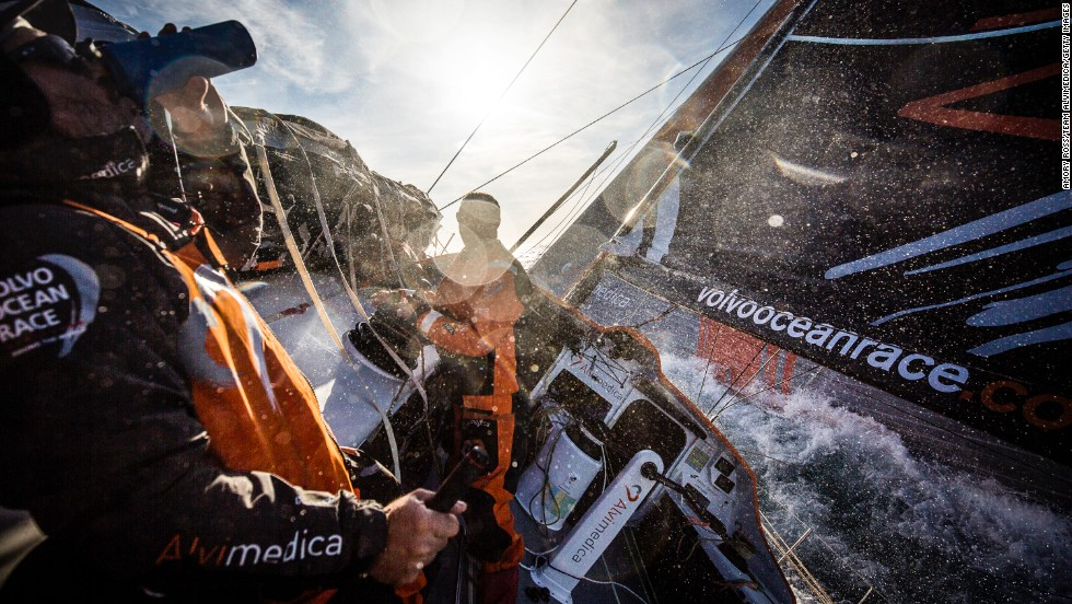 Ryan Houston of Team Alvimedica, left, gets the day started with some coffee on Wednesday, November 5, during the first leg of the Volvo Ocean Race between Alicante, Spain, and Cape Town, South Africa. The route spans some 39,379 nautical miles and visits 11 ports in 11 countries.