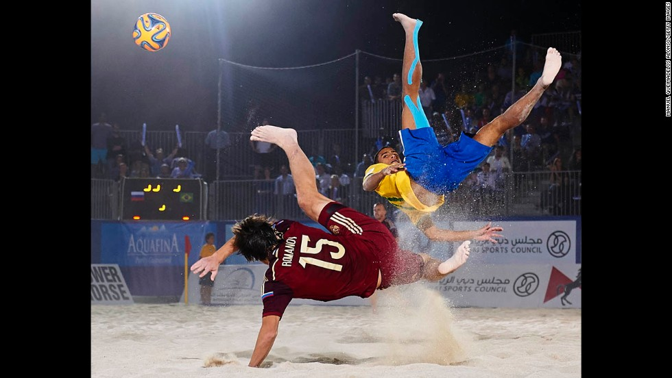 Rodrigo da Costa of Brazil, right, competes for the ball with Kirill Romanov of Russia during the 2014 Beach Soccer Intercontinental Cup final match in Dubai on Saturday, November 8. Brazil defeated Russia 3-2 in extra time.