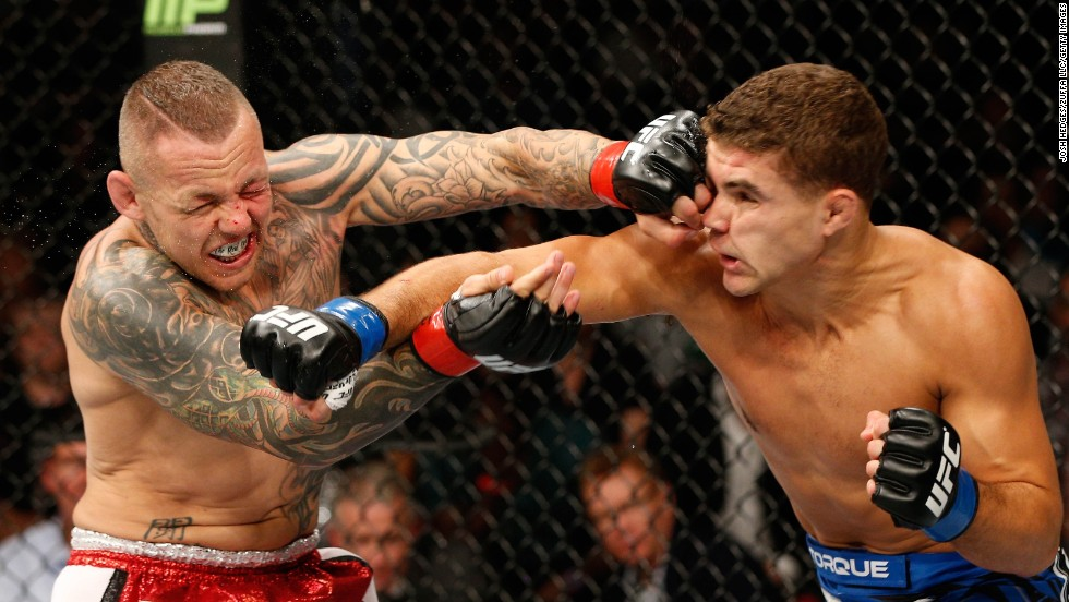 Ross Pearson, left, of England and Al Iaquinta of the United States trade punches in their lightweight bout during the UFC Fight Night event on Saturday, November 8, at Allphones Arena in Sydney, Australia. Iaquinta won in the second round.