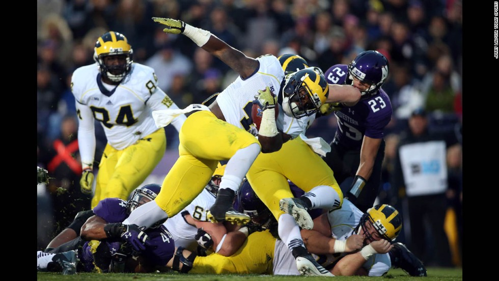 Michigan Wolverines running back De'Veon Smith scores a touchdown against the Northwestern Wildcats in the second half at Ryan Field in Evanston, Illinois, on Saturday, November 8. Michigan won 10-9.