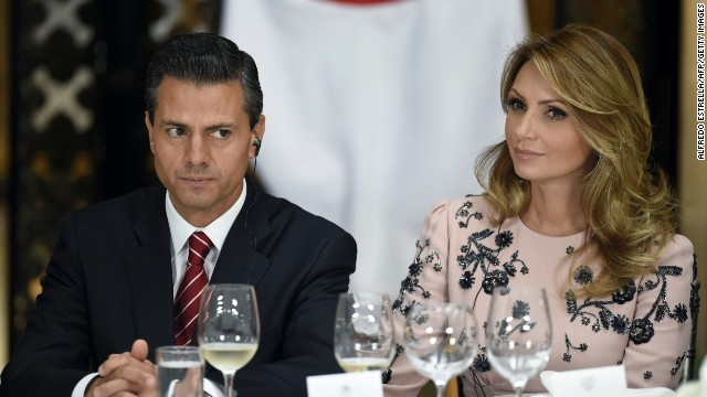 Mexican President Enrique Pena Nieto and his wife Angelica Rivera, during a dinner to honor Japanese Prime Minister Shinzo Abe (not framed) at the Nacional Palace in Mexico City, on July 25, 2014. The Prime Minister is in Mexico on a official visit for two days. AFP PHOTO/Alfredo ESTRELLA (Photo credit should read ALFREDO ESTRELLA/AFP/Getty Images)