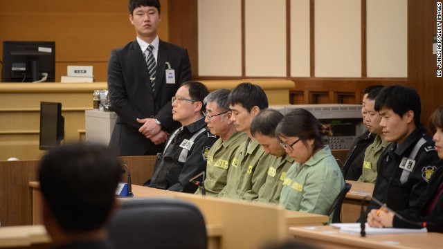 :Sewol ferry captain Lee Jun-Seok (3rd R) sits with other crew members inside a a court room in Gwangju at the start of the verdict proceedings on November 11, 2014. After five months of dramatic, often painful testimony, a South Korean court will deliver its verdict -- and possible death sentence -- on the ferry captain at the centre of one of the country's worst peacetime disasters. AFP PHOTO / POOL / Ed Jones (Photo credit should read ED JONES/AFP/Getty Images)